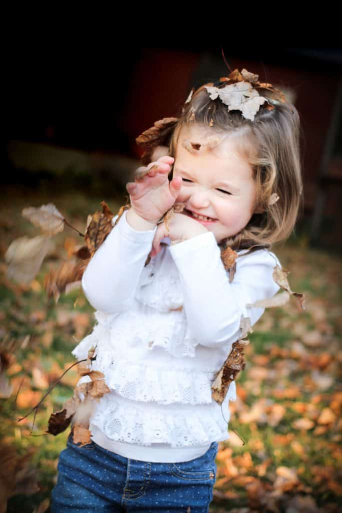 Little girl having fun. Kids photography tips
