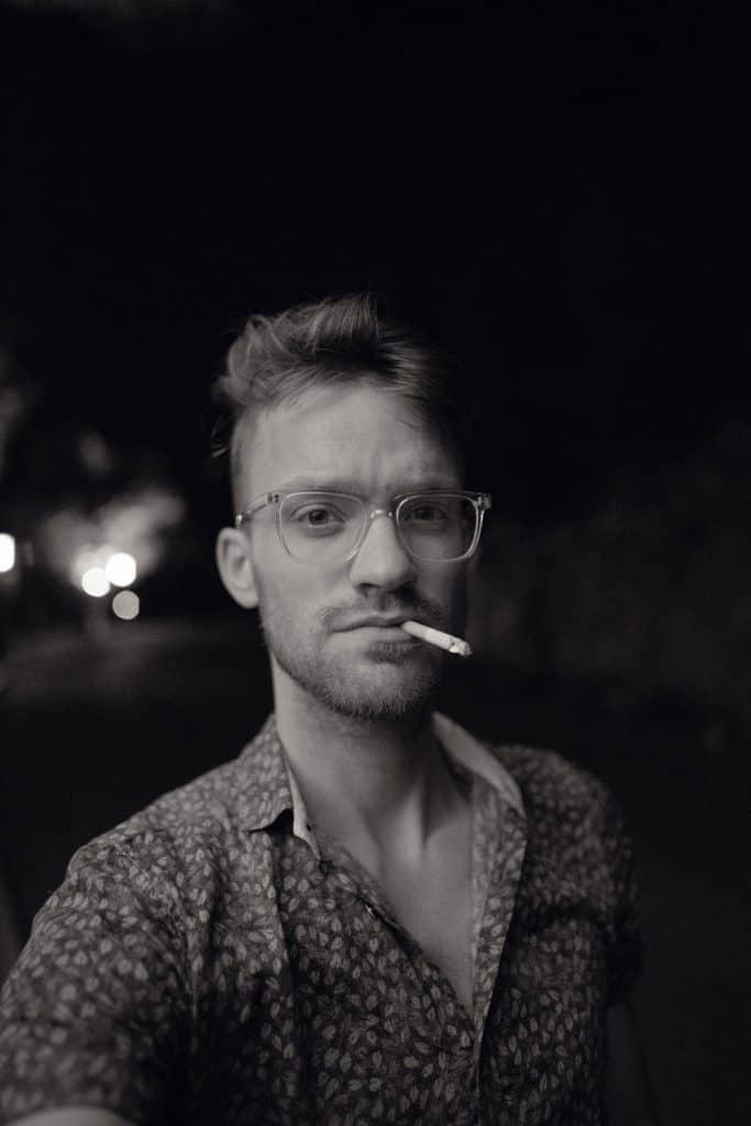 black and white image of a man smoking