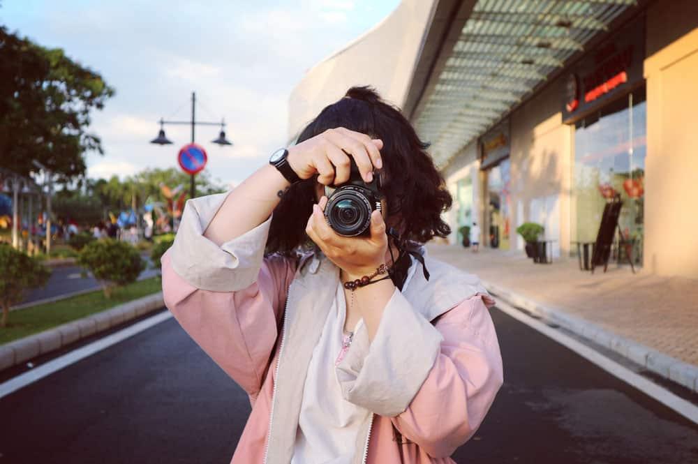 girl photographer taking photo