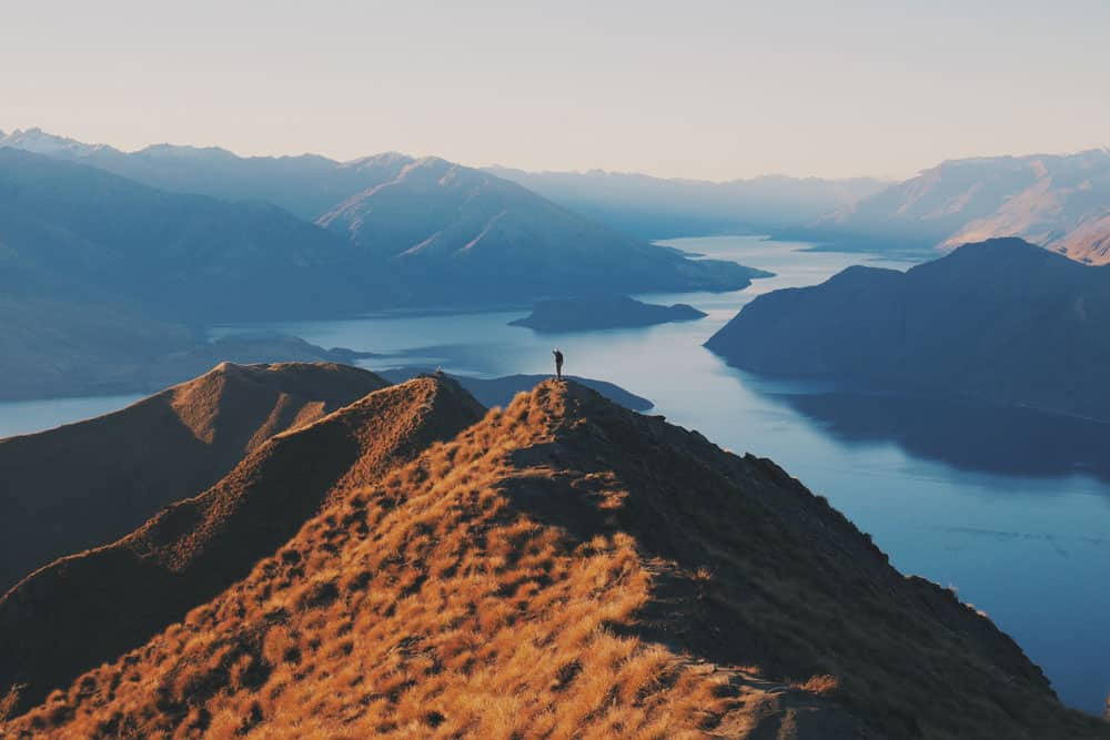 Landscape Photography Tips introduce the human element. Roys Peak NZ