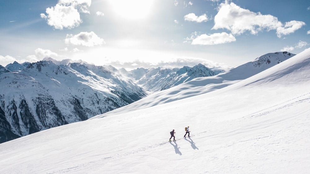 people hiking on a mountain
