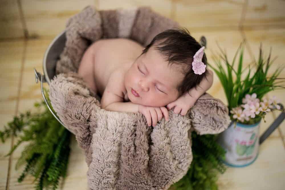 Newborn frog pose