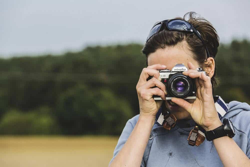 Photographer shooting using the EVF