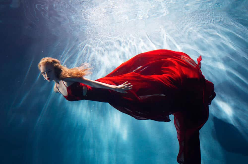 surreal photo of a lady in a red dress