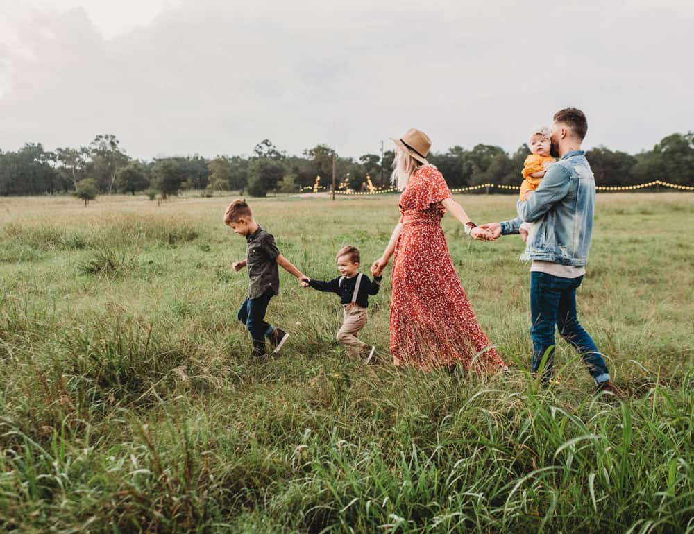 family walking during a photo shoot