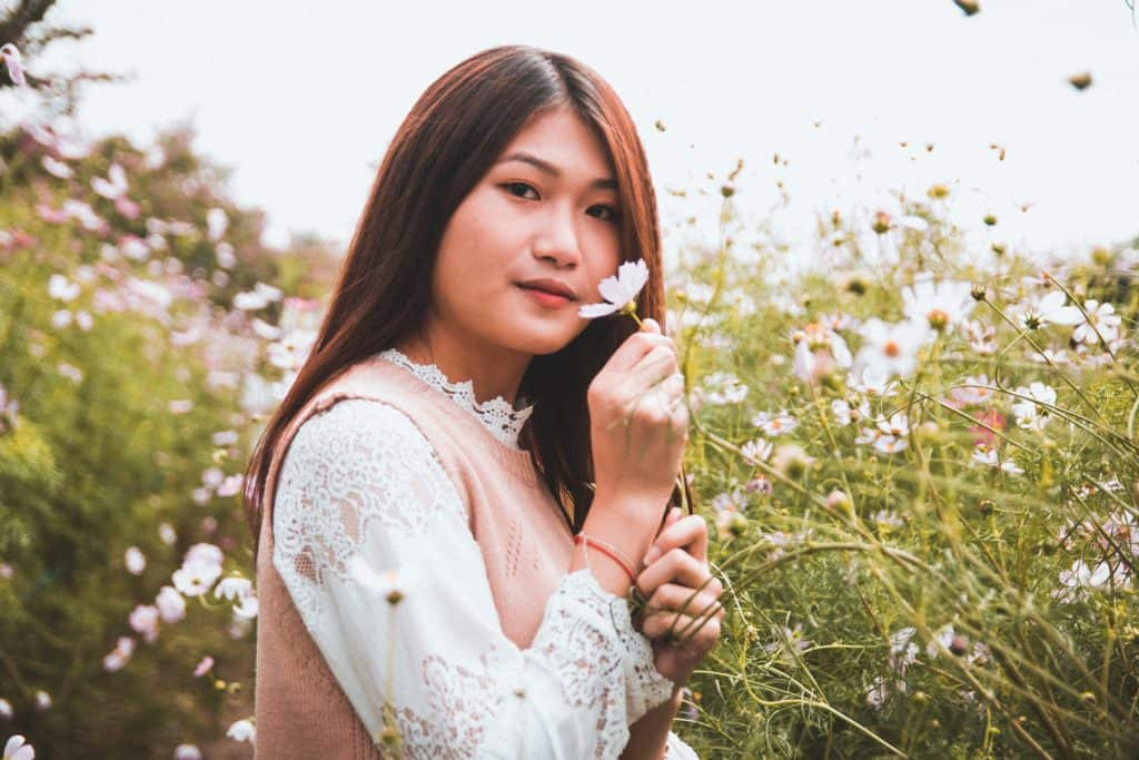 Model holding a flower