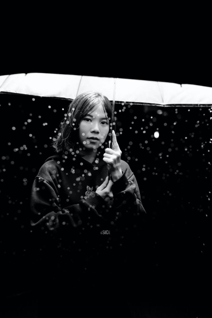 girl with umbrella at night