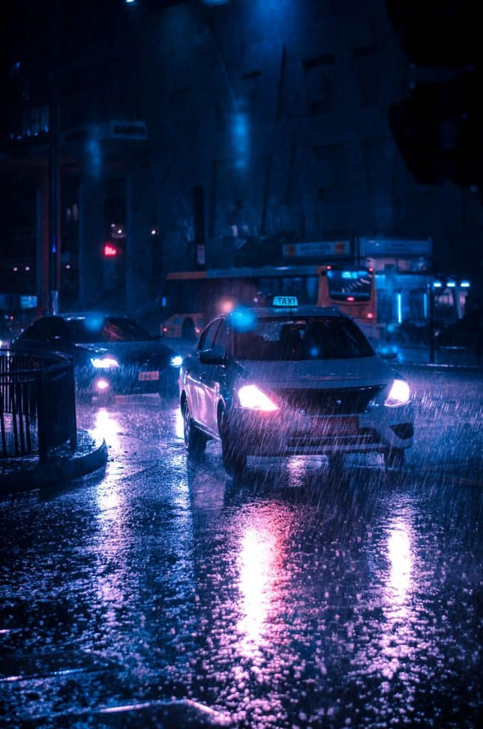 car lights at night with heavy rain
