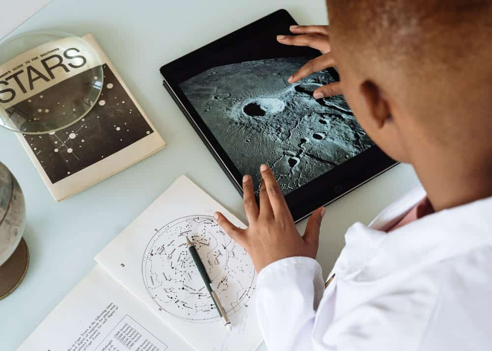 scientist using photos of the moon